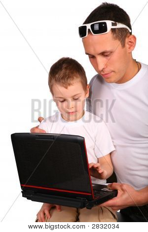 Father And Son Working With Notebook