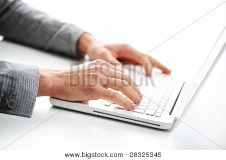 Businessman working at laptop