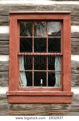 Old Orange Colored Window On A Wooden Log House