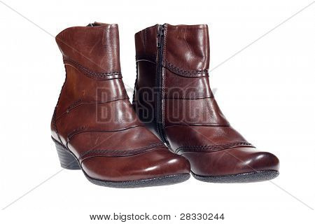 Pair of brown leather women's health boots isolated over white with clipping path