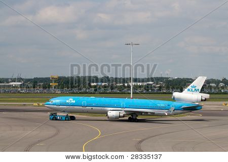 AMSTERDAM - JUNE 16: KLM Royal Dutch Airlines McDonnell Douglas MD-11 at Schiphol airport June 16, 2009 in Amsterdam, Netherlands. MD-11 is a three-engine medium to long range widebody jet airliner.