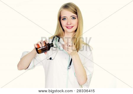 Female doctor pouring syrup