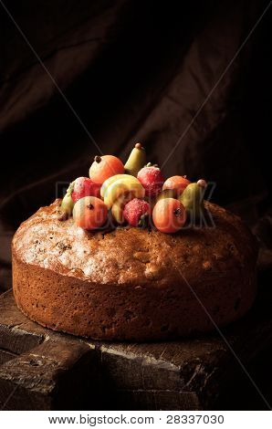 Homemade rich fruit cake decorated with hand crafted marzipan fruits