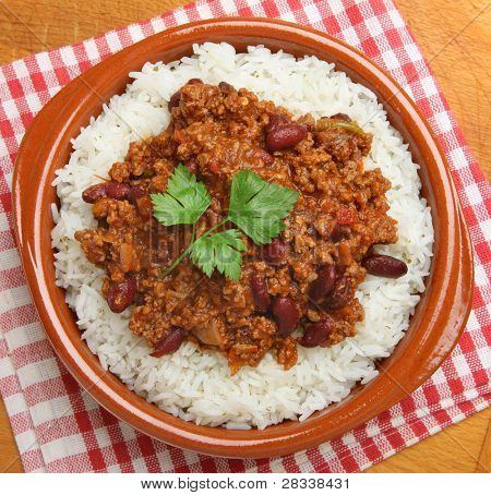 Chilli con carne with rice in terracotta dish