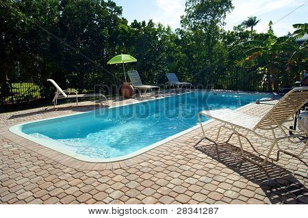 Rectangular Swimming Pool With Deck Chairs