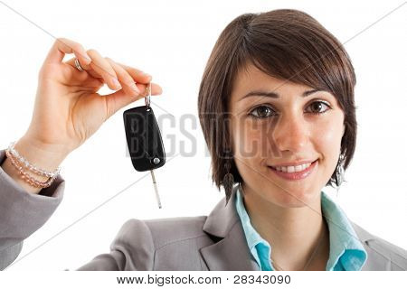 Portrait of a young woman holding a car key