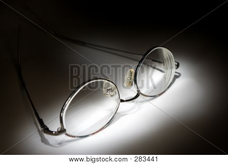 Open Glasses On White Background In The Darkness