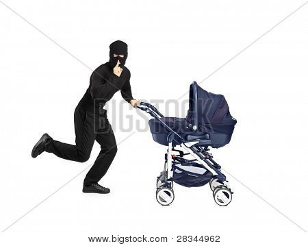 A man in robbery mask running and pushing a baby stroller with finger on the lips gesturing silence isolated on white background