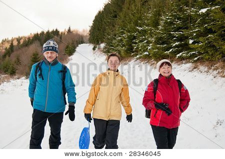 Family In Winter Together Walking In Snow