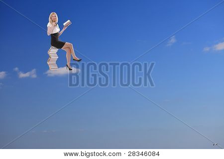 Woman Relax And Reading Book On The Cloud
