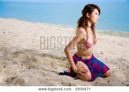 Woman Kneeling On The Beach
