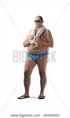 Fat man in swimsuit holding a beach towel