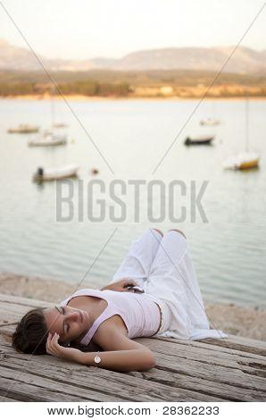 Laying beauty on lake shore