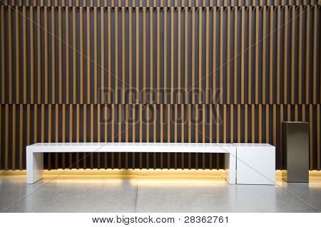 Modern waiting room with ashtray against wooden wall