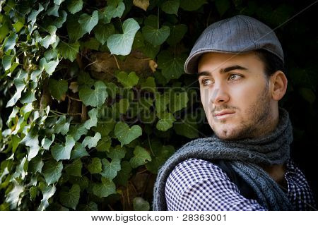 Young italian man in green garden