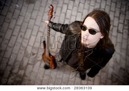 Young handsome musician in urban background