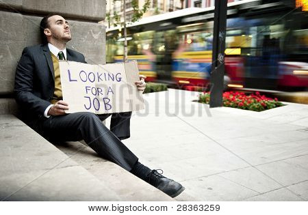 Businessman portrait looking for a job in urban background