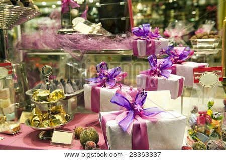 Gift boxes and sweets in shop window