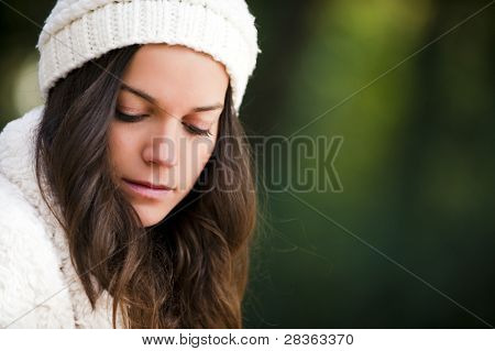 Young beautiful woman looking down with sadness face