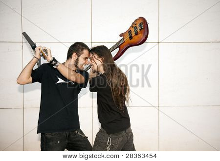 Two young musician fighting with their instruments