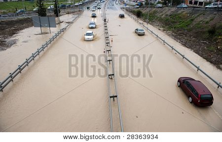 Cars going through flood highway and huge traffic jam (no trademarks)