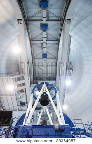 Indoor photography of telescope in a astronomical observatory.