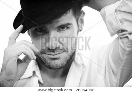 Young handsome man wearing black hat.