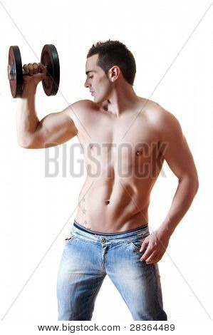 Sexy muscled man holding dumbell.