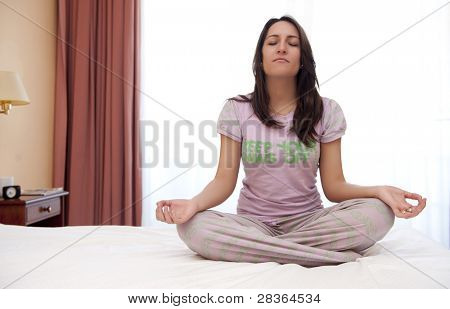Woman doing yoga in backlight photo.
