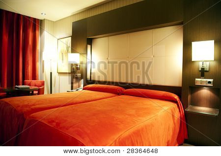 Luxury hotel room in red colors