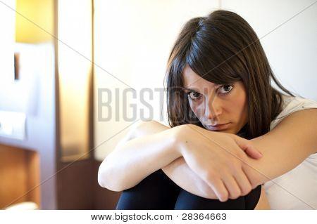 Young depressed woman staring at camera