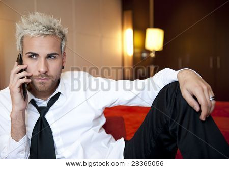 Attractive young business man making a phone call