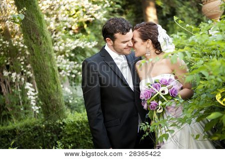 Bride at groom in green outdoors