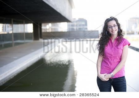 Cute young woman in urban background.