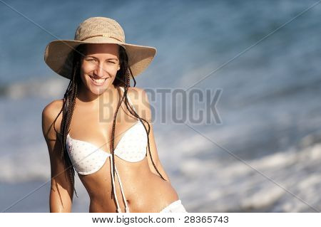 Young beautiful tanned girl smiling in copyspaced composotion.