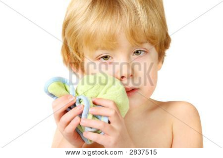 An Injured Boy Holding An Ice Pack On A Swollen Lip And Cheek