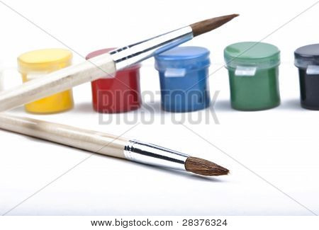 Paintbrush and paint on a white background