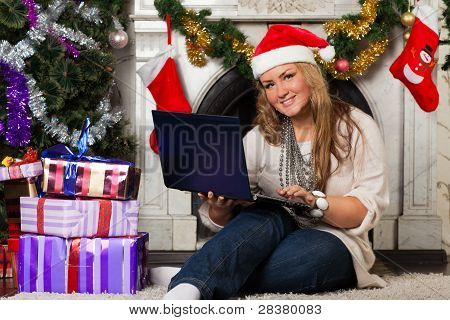 Woman With Notebook Near Christmas Tree.