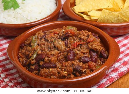 Beef chilli with tortilla chips and rice