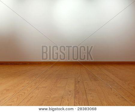 Leere weiße Wand mit Strahler und Holzboden
