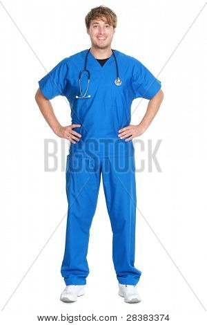 Male doctor or nurse standing isolated in full body on white background. Young medical professional. Caucasian man in his twenties wearing blue scrubs and stethoscope.