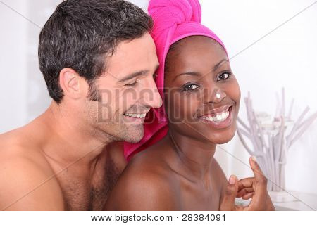 Couple getting ready in bathroom