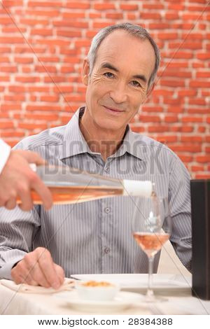Man drinking wine in a restaurant