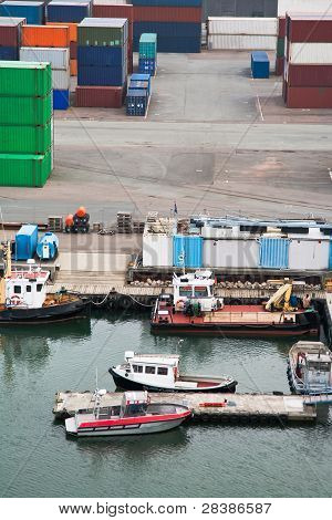 Boats And Freight Containers In Cargo Port