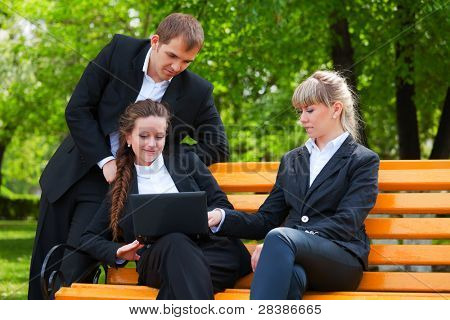 Young business people using laptop