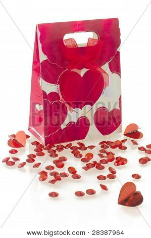 Red Gift Bag With Heart Pattern And Bow, Isolated On White Background.