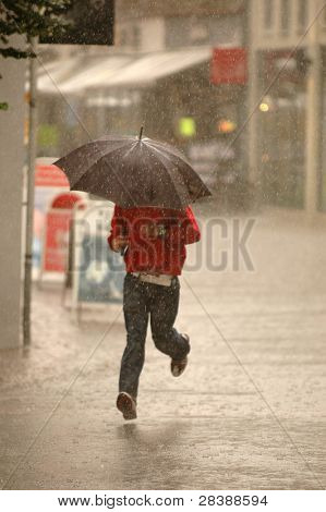 Man running in the rain. Motion blur.