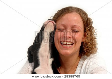 Young happy woman and her puppy.