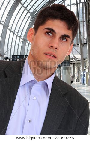 A handsome young business man at the train station