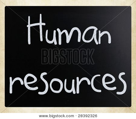 The Word 'human Resources' Handwritten With White Chalk On A Blackboard
